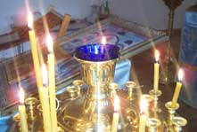 Candles in a gold and blue holder
