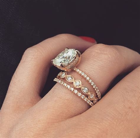 14k yellow gold engagement ring with a 5 carat cushion cut
