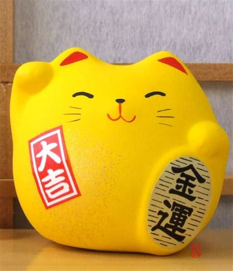 Maneki Neko Feng Shui Lucky yellow cat for good fortune in