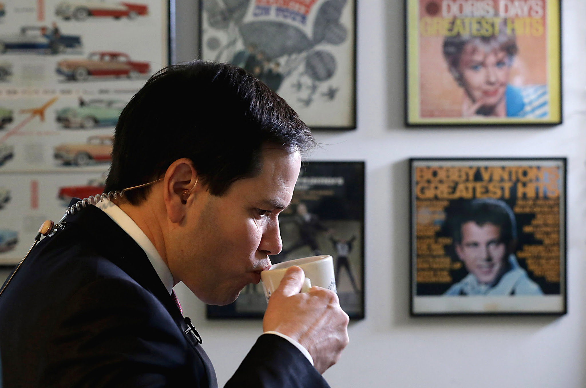 Marco Rubio Campaigns Ahead Of New Hampshire Primary...NASHUA, NH - FEBRUARY 08:  Republican presidential candidate Sen. Marco Rubio (R-FL) sips coffee before doing a television interview at Norton's Classic Cafe during a campaign stop February 8, 2016 in Nashua, New Hampshire. Rubio is hoping for a good showing on Tuesday when people in New Hampsire head to the polls in the 'First in the Nation' presidential primary.  (Photo by Chip Somodevilla/Getty Images) **BESTPIX**