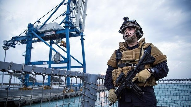 Guard on the Norwegian frigate Helge Ingstad as it leaves the port of Limassol in Cyprus, part of the Danish-Norwegian force that will transport Syria's chemical agents out of the country to destruction.