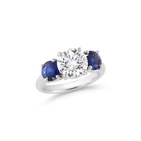 Round Brilliant Three Stone Diamond & Sapphire Engagement