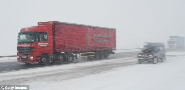 Plough on! Vehicles drive through heavy snow on the A66 near to Bowes in County Durham