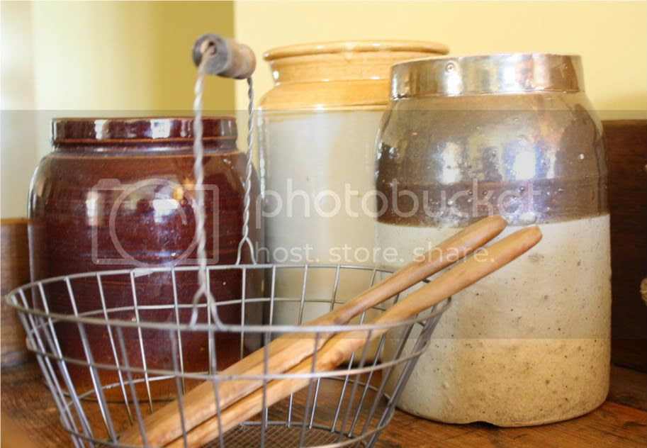 old stoneware crocks, butter paddles, wire basket