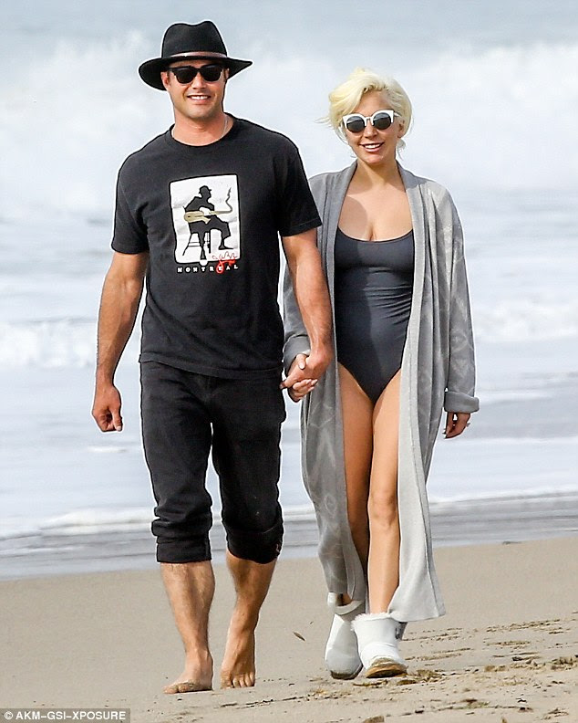 Romantic recovery: Lady Gaga and Taylor Kinney went fro a stroll along a Malibu, California, beach on Monday after her Golden Globe win