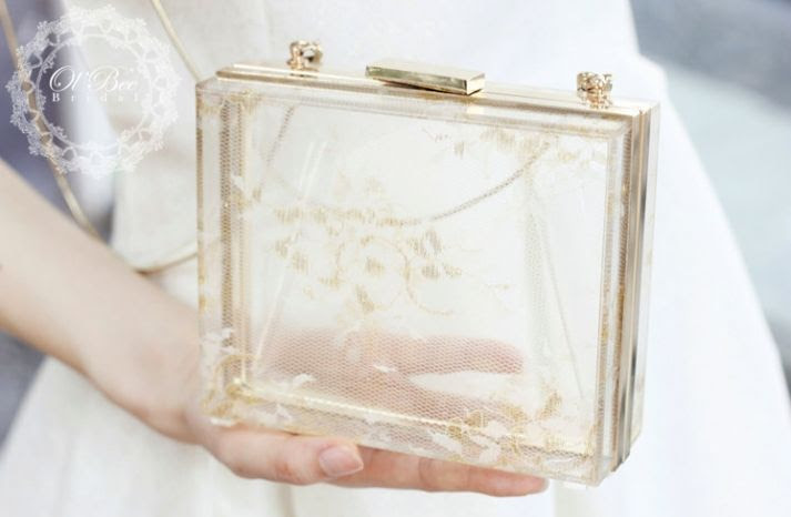 Transparent gold and lace clutch for the bride