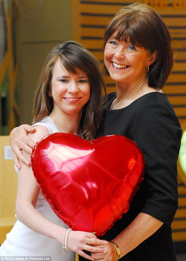Kaylee Davidson-Olley, pictured with her mother Carol, has celebrated her 25th anniversary of becoming the UK's first ever successful baby heart transplant. She was just four months old when the had the operation at the  Freeman Hospital, Newcastle.