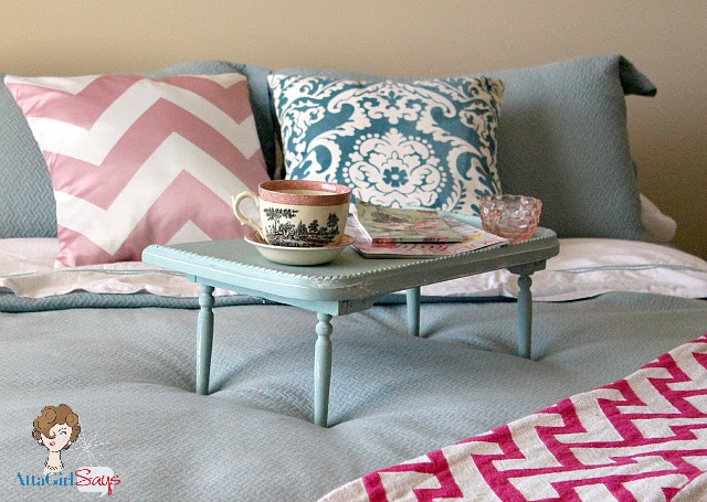 Aqua and Pink guest bedroom bed with chevron and damask pillow and greek key blanket