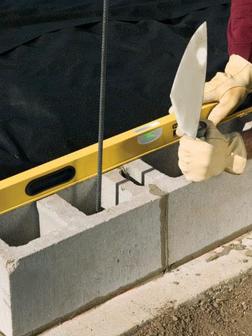 Install Bifold Doors New Construction Building A Retaining Wall