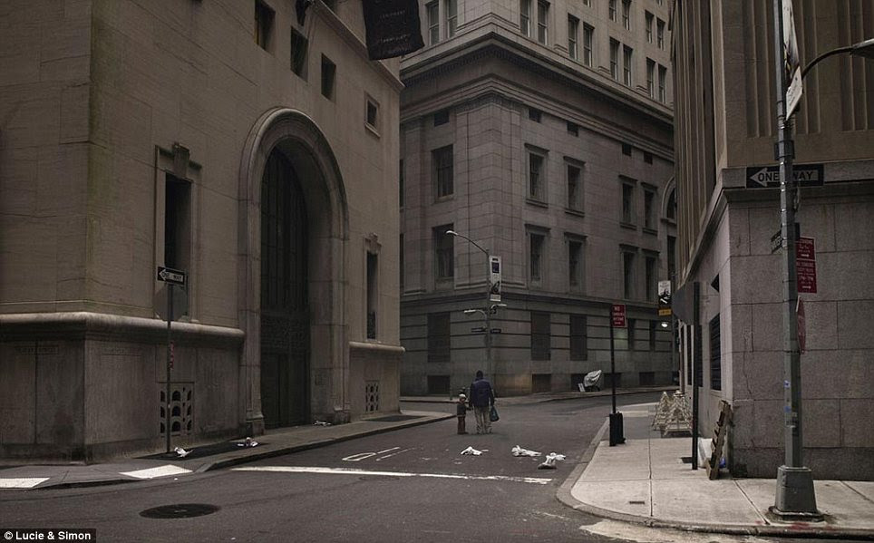 No one left to occupy: A man and a child pause in the middle of Wall Street in this image