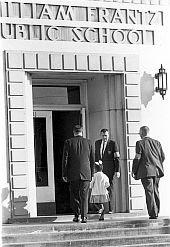 Ruby Bridges being escorted into school, November 1960.