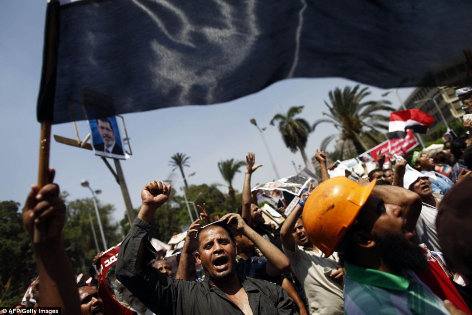 Supporters of the Muslim Brotherhood and ousted Egyptian president Mohamed Morsi shout slogans during a protest
