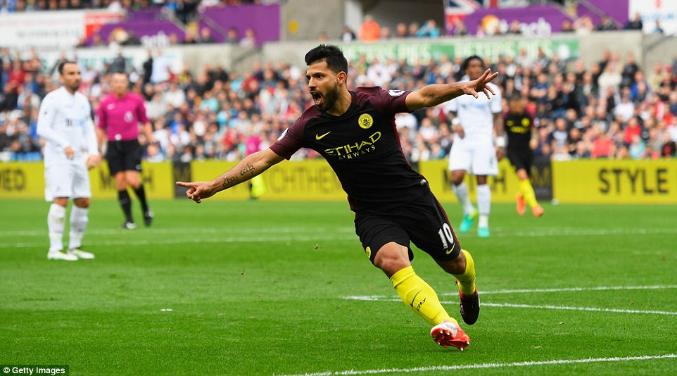 Argentine striker Sergio Aguero turns away to celebrate with the City fans after giving his side the lead at Swansea