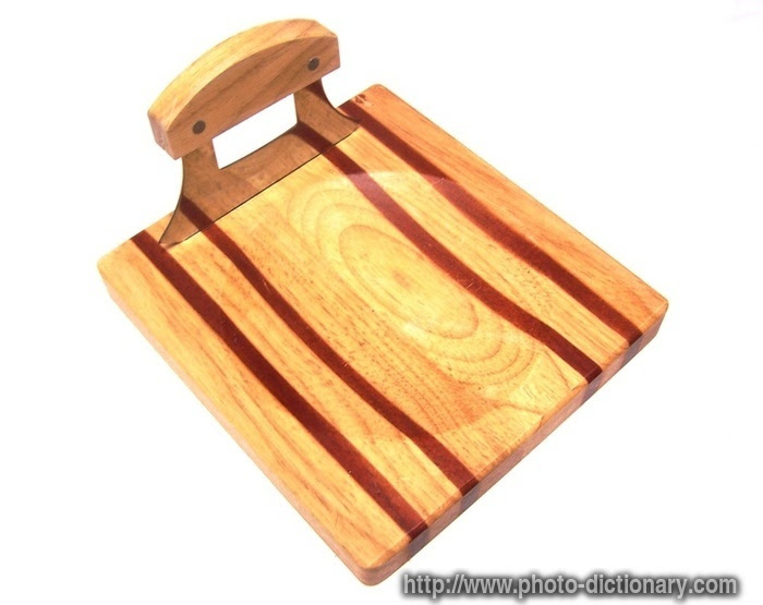 chopping board - photo/picture definition at Photo Dictionary ...