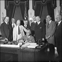 Present Franklin Delano Roosevelt Signing the Glass-Steagall Act on June 16, 1933