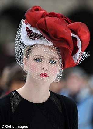 Cold elegance: A skater wears a extravagant red creation with a veil