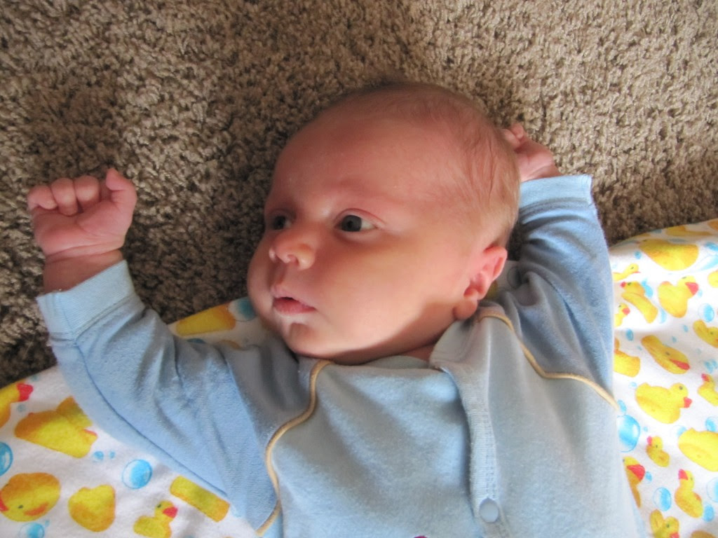 TITAN POSE! Random tidbit... every baby does this pose when their head is turned, it prepares them for rolling.