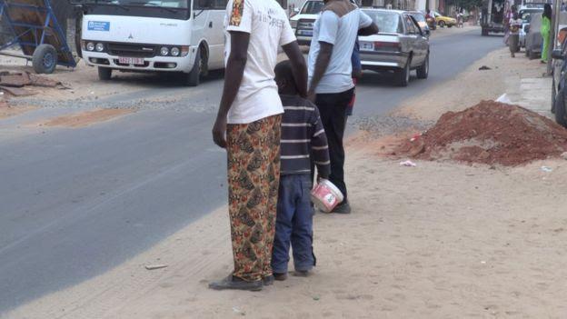 Man with child on street