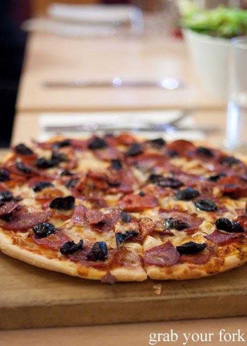 Sicilian pizza with olives and salami at Bella Cafe, Kingscote, Kangaroo Island