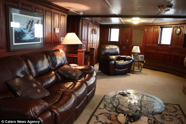 The ship still contains wood paneled state rooms, dining room and lounge designed by Henry Ford