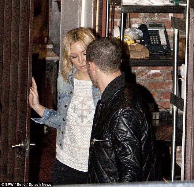 More than friends? Seemingly keen to go under the radar, the Almost Famous actress and the Jealous crooner attempted to exit unnoticed as they sauntered out of the restaurant's back door