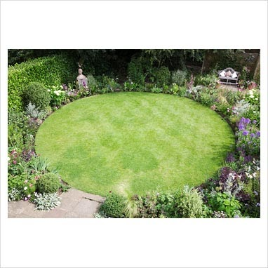Modern Country Style Small Garden With A Circular Lawn