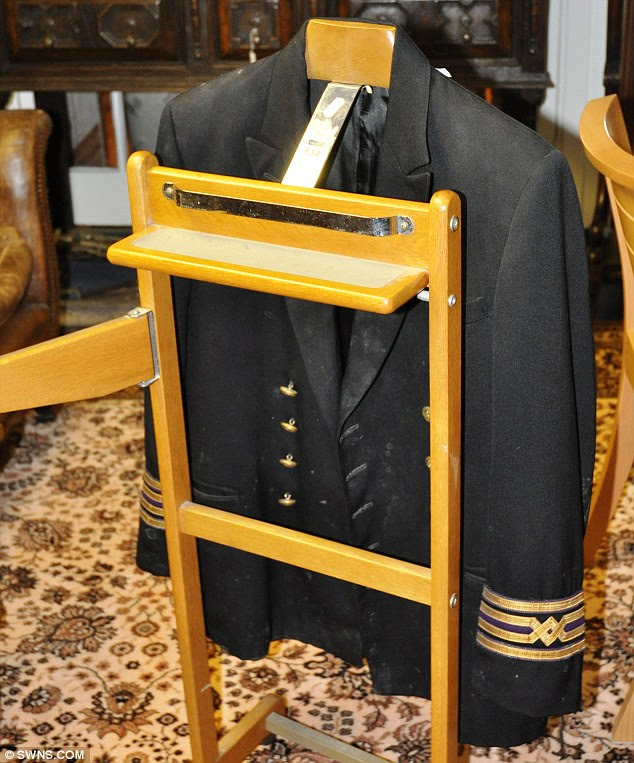 Letting go: A number of other items are also being sold - some of which may also have featured in Vettriano's work - including this black officers jacket with quadruple gold banded cuffs