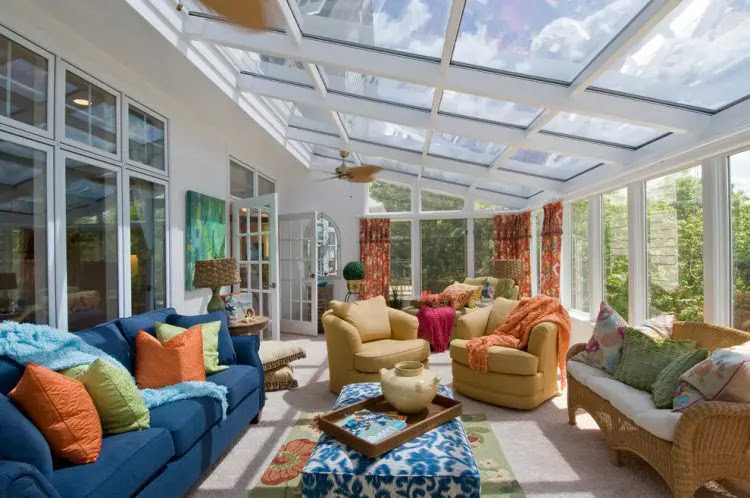 traditional sunroom design with two conversation zones 750x498