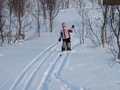 Eirin skiing down the hill