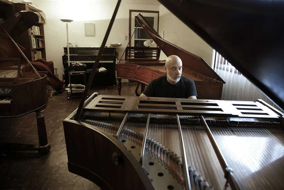 Keyboardist John Khouri plays an 1832 piano by John Broadwood and Sons, which he keeps in his basement in Vallejo. Photo: Liz Hafalia, The Chronicle