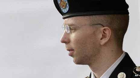 Army Pte Bradley Manning is escorted to a security vehicle outside a courthouse in Fort Meade, Maryland 18 July 2013