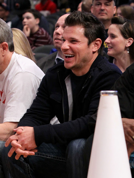 Singer  Nick Lachey attends the game between the Louisville Cardinals and the  Cincinnati Bearcats during the second round of 2010 NCAA Big East  Tournament at Madison Square Garden on March 10, 2010 in New York City.