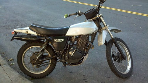 Suzuki DR370 parked on the street. Looks fun.