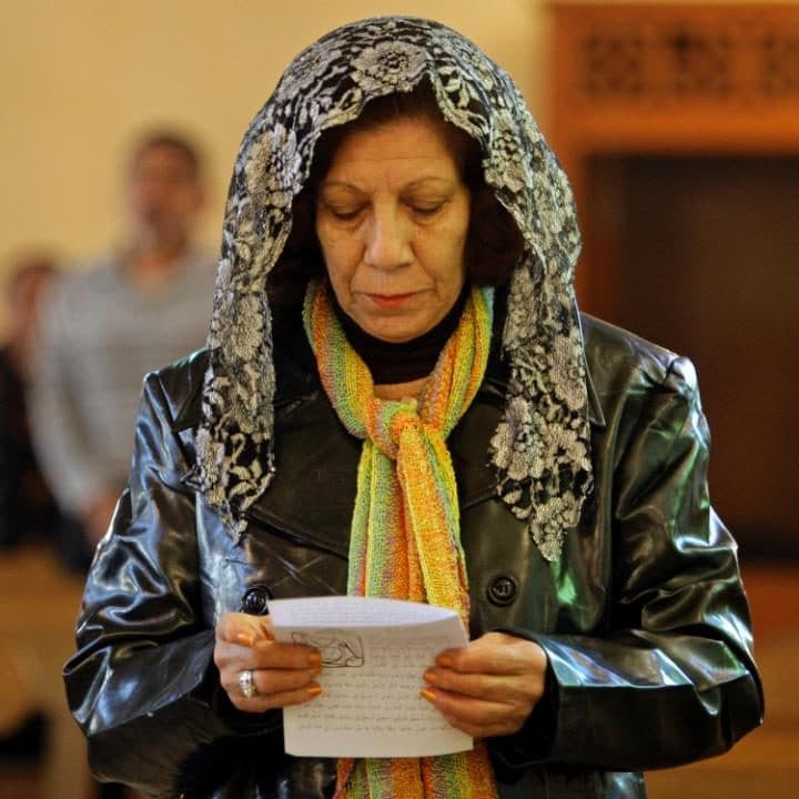 An Iraqi woman worships at the Mar Youssif Chaldean Church in Baghdad in 2009