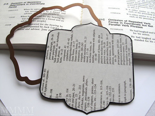 7 die cut dictionary page with a nestabilities label 5 shape to make a mat