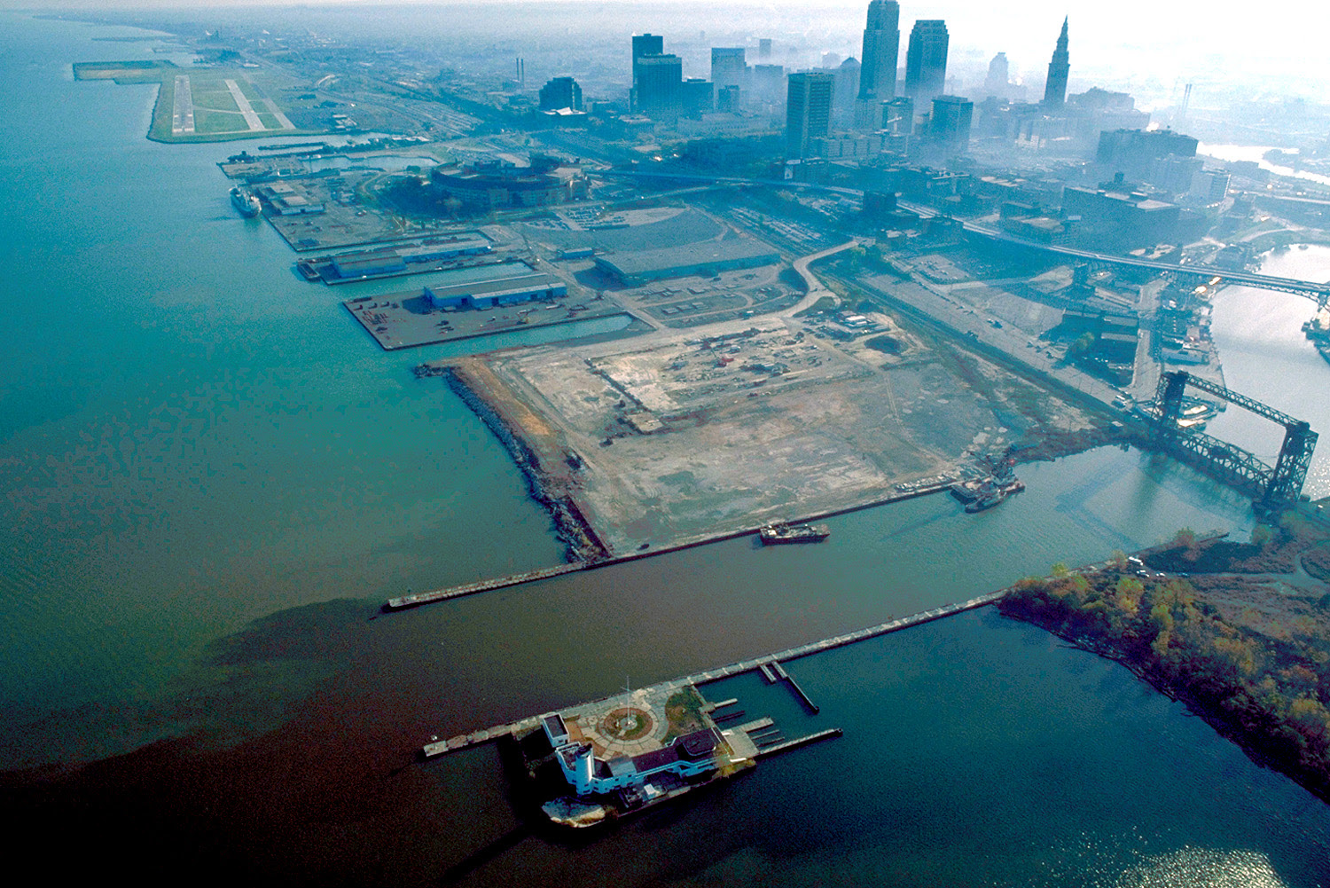 1992 aerial view of the Cleveland harbor, with the mouth of the Cuyahoga River in the foreground. View is to the east.