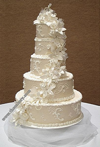five tier round cake decorated with gum paste flowers