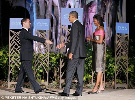 Russian President Dmitry Medvedev (L) is greeted by US President Barack Obama (C) and his wife Michelle (R) upon his arrival at the dinner for the Asia-Pacific Economic Cooperation (APEC) summit meeting in Honolulu, Hawaii on November 12, 2011.