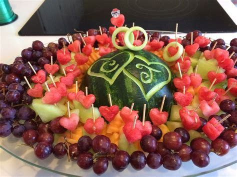 Watermelon fruit tray with wedding rings. Rings made from
