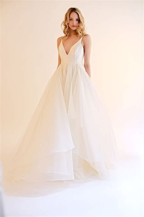 The Gabrielle is an Ivory silk deep V neck gown with an