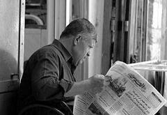 Man reading Arabic newspaper in Old City of Jerusalem