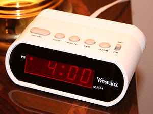 A typical digital 12-hour alarm clock indicati...