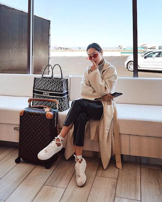 Le Fashion Blog Travel Outfit Aimee Song Red Micro Sunglasses Grey Turtleneck Cream Robe Coat Leather Pants White Sneakers Via @Songofstyle