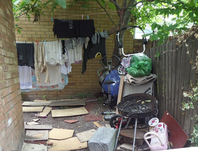 The back garden of the house, which was also in disrepair. Officers found that 26 Romanians were living there, including four families and a young child