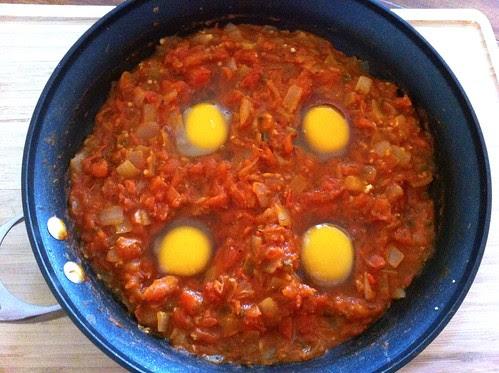 4 Eggs Cracked into Tomato Sauce