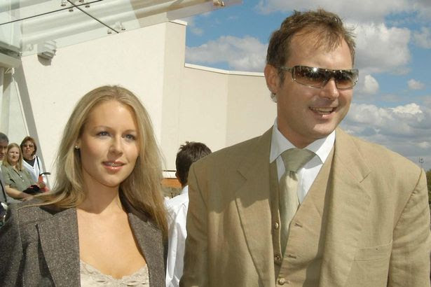 John Leslie and his girlfriend Abi Titmuss in August 2003
