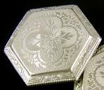 Elegantly engraved platinum and gold cufflinks. (J9118)