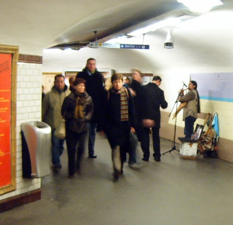 Busker on the Metro