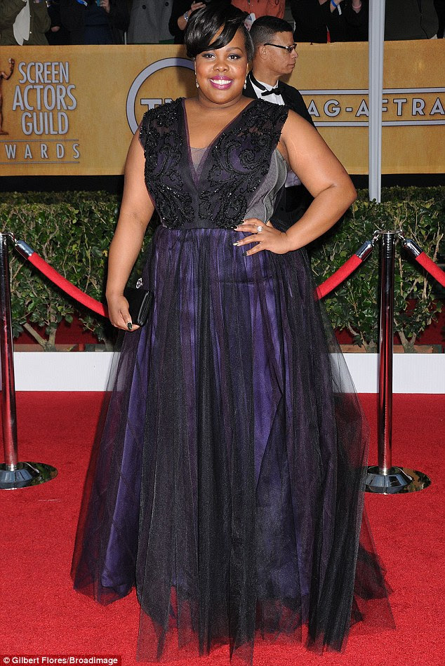 What was she thinking? Amber Riley misfired in this sheer black and purple number