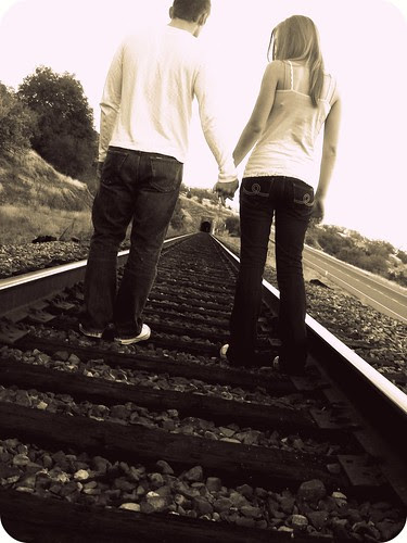 holding hands train tracks